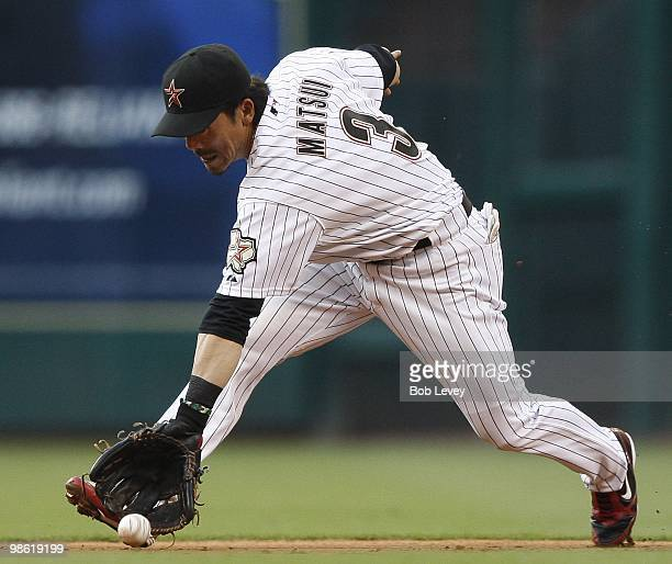 Second baseman Kazuo Matsui of the Houston Astros throws to first base to retire Hanley Ramirez of the Florida Marlins at Minute Maid Park on April...