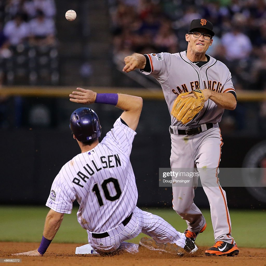 Second baseman Kelby Tomlinson #37 of the San Francisco Giants turns a double play on Ben Paulsen #10 of the Colorado Rockies in the second inning at Coors Field on September 4, 2015 in Denver, Colorado.