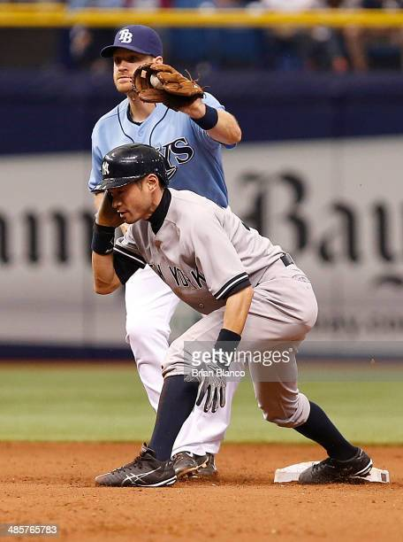 Second baseman Logan Forsythe of the Tampa Bay Rays catches Ichiro Suzuki of the New York Yankees attempting to steal second base during the 11th...