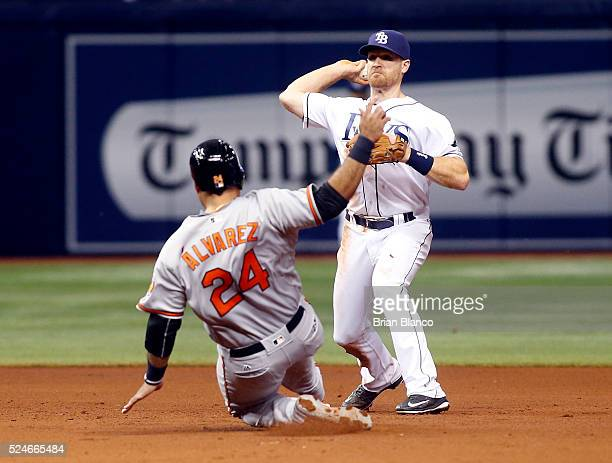 Second baseman Logan Forsythe of the Tampa Bay Rays gets the forced out at second base on Pedro Alvarez of the Baltimore Orioles then turns the...
