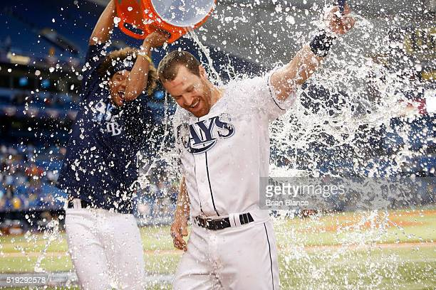 Second baseman Logan Forsythe of the Tampa Bay Rays is doused with ice and water from the cooler by pitcher Chris Archer following the Rays' 32 win...