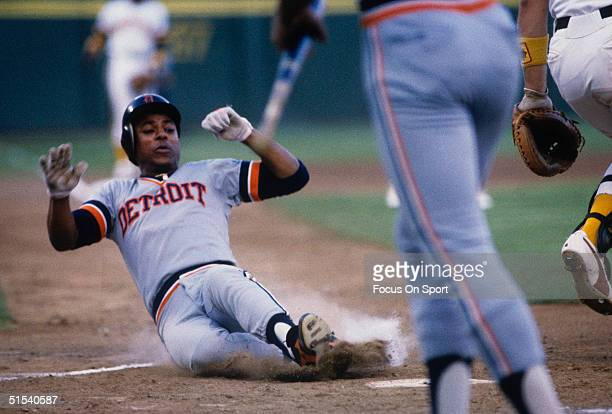 Second baseman Lou Whitaker of the Detroit Tigers slides across the home plate during the World Series against the San Diego Padres at Jack Murphy...
