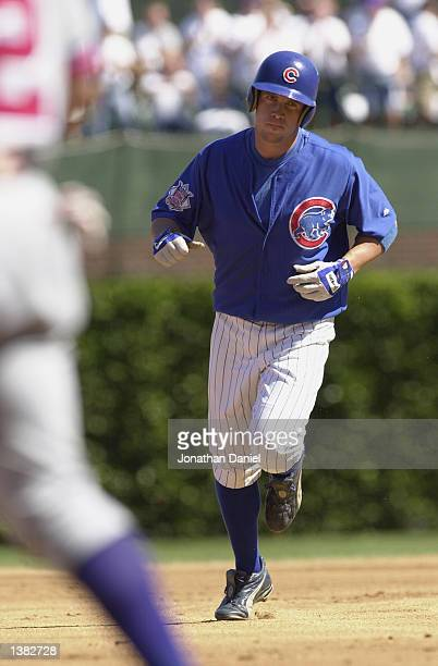 Second Baseman Mark Bellhorn of the Chicago Cubs rounds the bases after hitting a first game pitch home run his 27th of the season against pitcher...