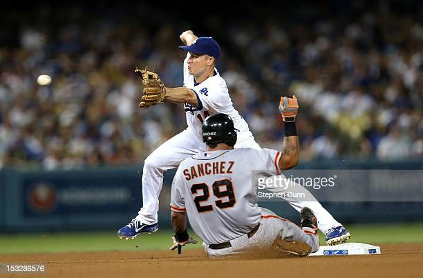 Second baseman Mark Ellis of the Los Angeles Dodgers takes a throw to force out Hector Sanchez of the San Francisco Giants in the fifth inning on...
