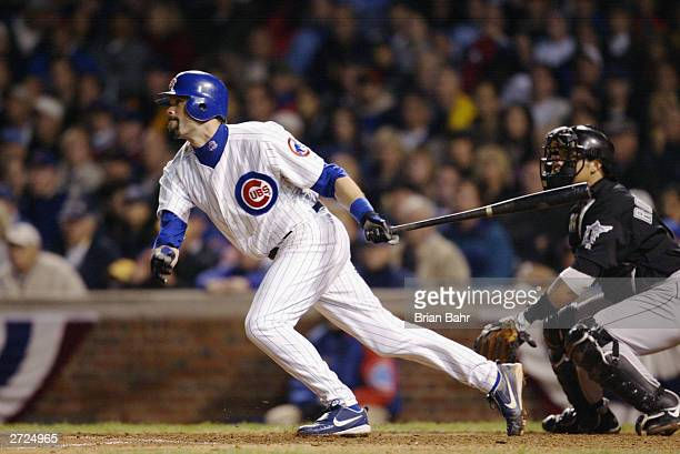 Second baseman Mark Grudzielanek of the Chicago Cubs hits the ball during game six of the National League Championship Series against the Florida...