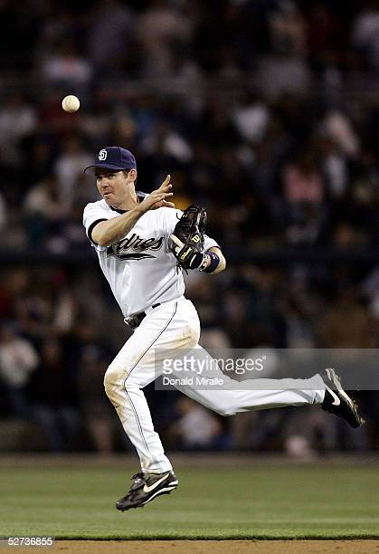 Second baseman Mark Loretta of the San Diego Padres throws the ball while airborne for the final out of the sixth inning against the Arizona...