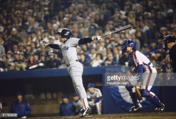 Second baseman Marty Barrett of the Boston Red Sox swings for the fences during the World Series against the New York Mets at Shea Stadium on October...