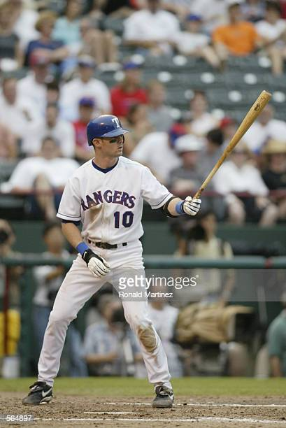 Second baseman Michael Young of the Texas Rangers waits for the pitch during the MLB game against the Detroit Tigers at The Ballpark in Arlington...
