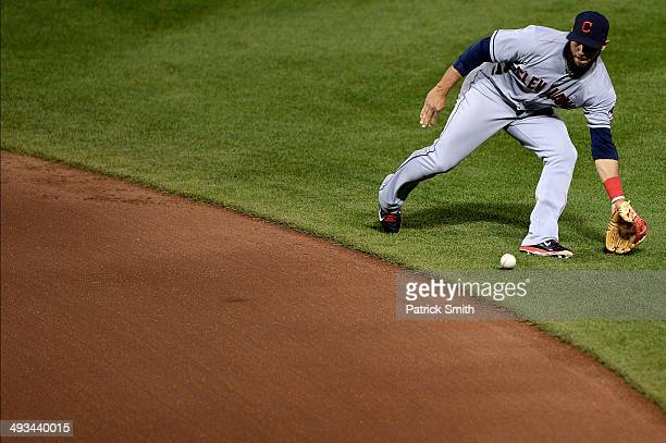 Second baseman Mike Aviles of the Cleveland Indians makes a play on Ryan Flaherty of the Baltimore Orioles in the fourth inning at Oriole Park at...