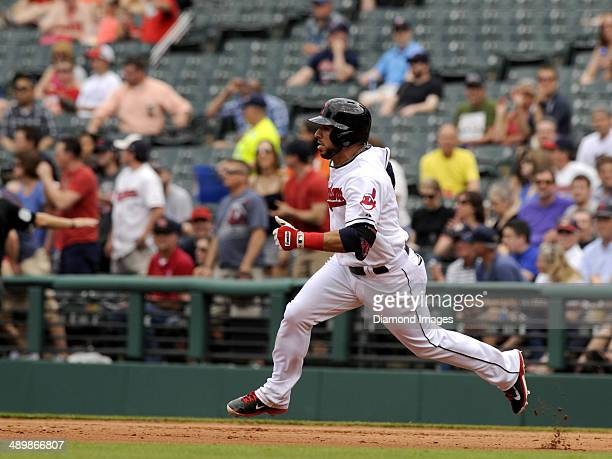 Second baseman Mike Aviles of the Cleveland Indians runs toward second base after hitting a double during a game against the Minnesota Twins on May 8...