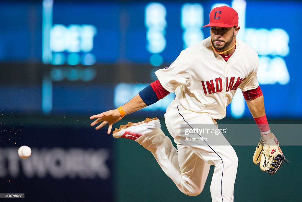 Second baseman Mike Aviles #4 of the Cleveland Indians tries to grab a deflected ground ball hit by Melky Cabrera #53 of the Chicago White Sox during the seventh inning at Progressive Field on July 25, 2015 in Cleveland, Ohio.