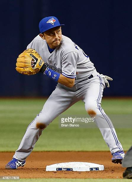 Second baseman Munenori Kawasaki of the Toronto Blue Jays gets the forced out at second base on Brandon Guyer of the Tampa Bay Rays then turns the...