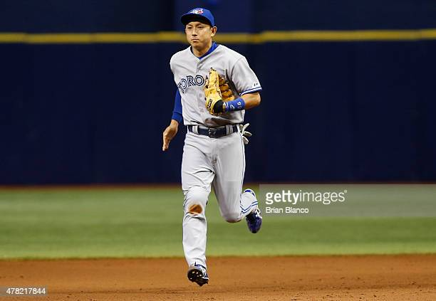Second baseman Munenori Kawasaki of the Toronto Blue Jays makes his way to the dugout at the end of the eighth inning of a game against the Tampa Bay...