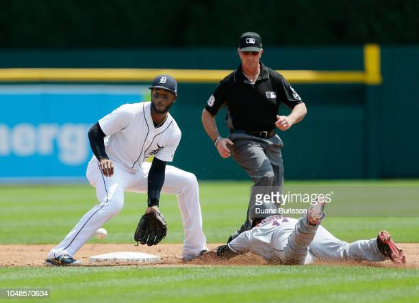 Second baseman Niko Goodrum of the Detroit Tigers fields the pickoff throw too late to tag Jose Ramirez of the Cleveland Indians stealing second base...