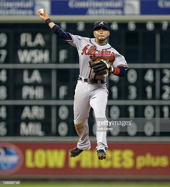 Second baseman Omar Infante of the Atlanta Braves makes a throw from deep in the hole against the Houston Astros at Minute Maid Park on August 10...