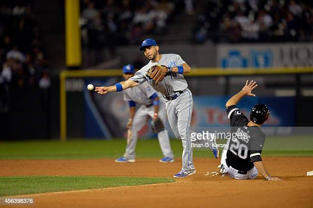 Second baseman Omar Infante of the Kansas City Royals throws to first base after forcing out Jordan Danks of the Chicago White Sox at second base on...