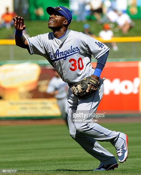 Second baseman Orlando Hudson of the Los Angeles Dodgers looks to catch a popup against the San Francisco Giants during a spring training game at...