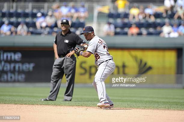 Second baseman Ramon Santiago of the Detroit Tigers throws to first base after fielding a ground ball against the Kansas City Royals on July 21 2013...