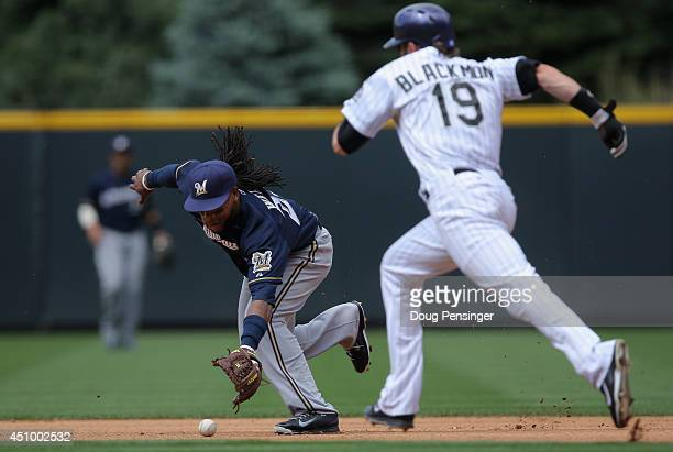Second baseman Rickie Weeks of the Milwaukee Brewers commits an error on a ground ball by Drew Stubbs of the Colorado Rockies allowing Charlie...