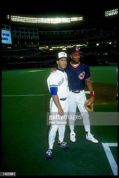 Second baseman Roberto Alomar of the Toronto Blue Jays stands with Sandy Alomar of the Cleveland Indians during the AllStar Game at the Toronto Sky...
