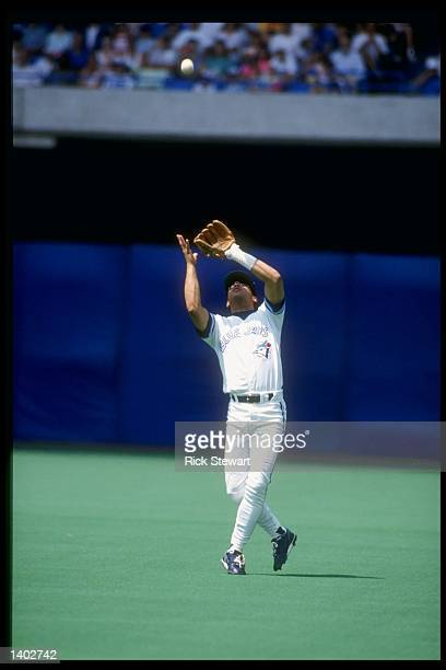 Second baseman Roberto Alomar of the Toronto Blue Jays tries to catch a pop fly during a game at the Toronto Sky Dome in Toronto, Canada. Mandatory...