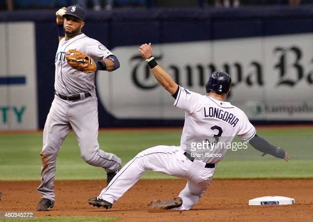 Second baseman Robinson Cano of the Seattle Mariners gets the out at second base on Evan Longoria of the Tampa Bay Rays then turns the double play to...
