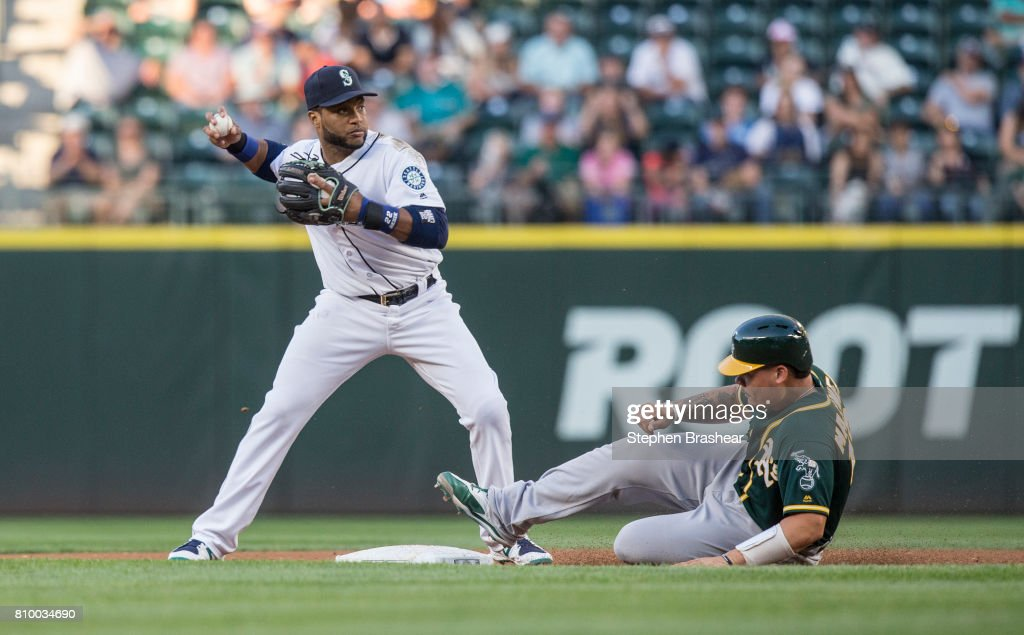 Second baseman Robinson Cano #22 of the Seattle Mariners starts to turn a double play before pulling the ball back after forcing out Bruce Maxwell #13 of the Oakland Athletics on a ball hit by Matt Chapman #26 of the Oakland Athletics during the fourth inning of a game at Safeco Field on July 6, 2017 in Seattle, Washington. Chapman was safe at first base on a fielder's choice. The Athletics won the game 7-4.