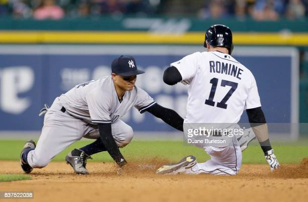 Second baseman Ronald Torreyes of the New York Yankees tags out Andrew Romine of the Detroit Tigers trying to stretch a hit into a double during the...