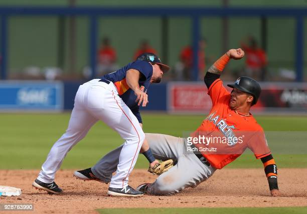 Second baseman Ryan Birk of the Houston Astros tags out Isan Diaz of the Miami Marlins attempting to steal during the sixth inning of a spring...