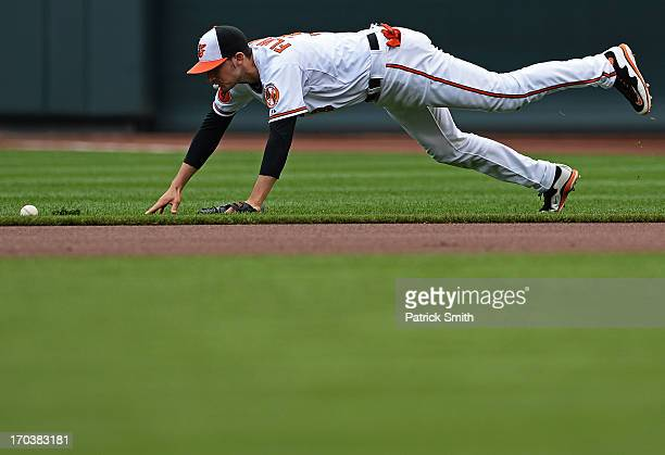 Second baseman Ryan Flaherty of the Baltimore Orioles cannot grab a ball hit by JB Shuck of the Los Angeles Angels of Anaheim in the first inning at...