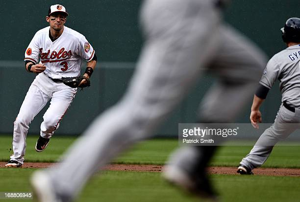 Second baseman Ryan Flaherty of the Baltimore Orioles chases down Jedd Gyorko of the San Diego Padres for an out in the fifth inning at Oriole Park...