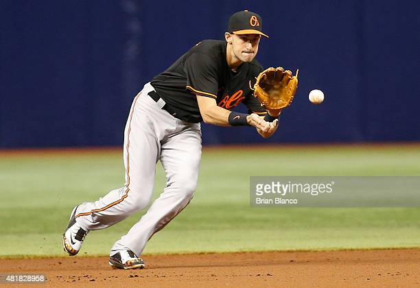 Second baseman Ryan Flaherty of the Baltimore Orioles fields the ground out by Evan Longoria of the Tampa Bay Rays to end the first inning of a game...