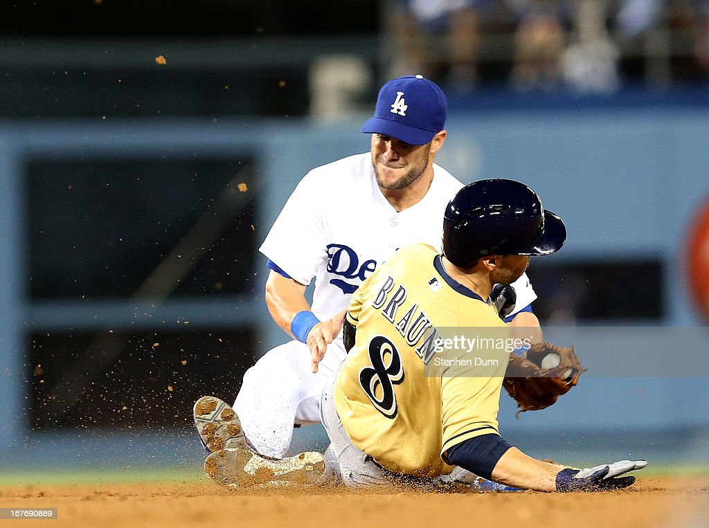 Second baseman Skip Schumaker #3 of the Los Angeles Dodgers tags out Ryan Braun #8 of the Milwaukee Brewers trying to steal second in the seventh inning at Dodger Stadium on April 27, 2013 in Los Angeles, California.