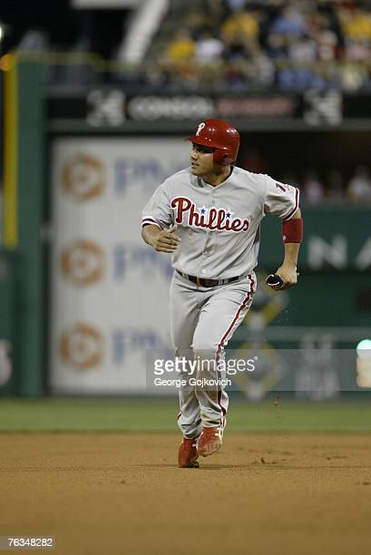 Second baseman Tadahito Iguchi of the Philadelphia Phillies runs between second and third base during a game against the Pittsburgh Pirates at PNC...