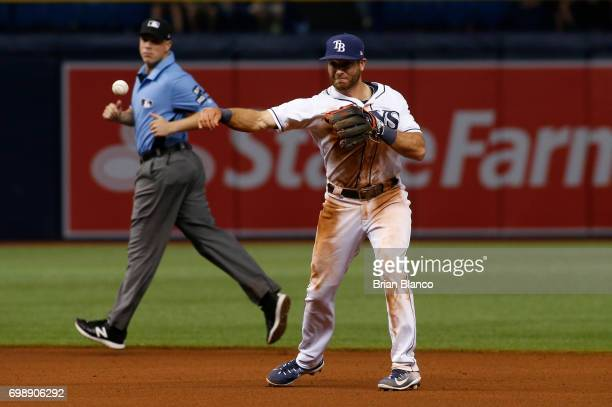 Second baseman Taylor Featherston of the Tampa Bay Rays fields the ground out by Billy Hamilton of the Cincinnati Reds during the seventh inning of a...