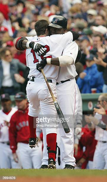 Second baseman Todd Walker and David Ortiz of the Boston Red Sox hug at home plate against the Oakland Athletics in game four of the American League...