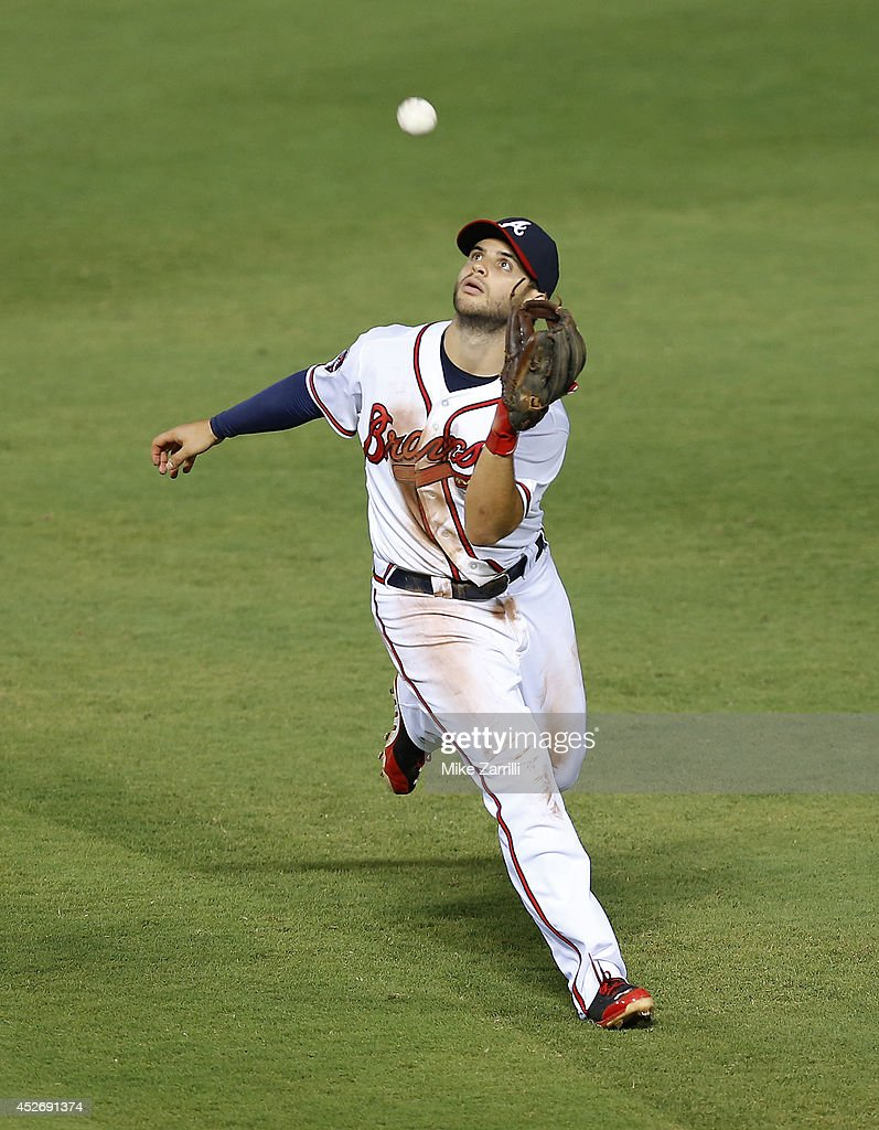 Second baseman Tommy La Stella #7 of the Atlanta Braves catches a pop up during the game against the San Diego Padres at Turner Field on July 25, 2014 in Atlanta, Georgia.
