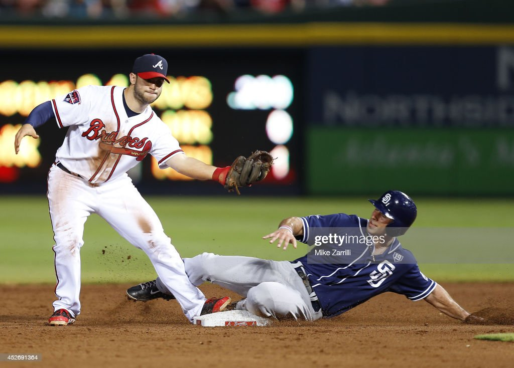 Second baseman Tommy La Stella #7 of the Atlanta Braves makes a force play at second base while first baseman Tommy Medica #14 slides into second base during the game at Turner Field on July 25, 2014 in Atlanta, Georgia.
