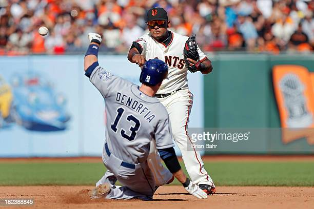 Second baseman Tony Abreau of the San Francisco Giants forces out Chris Denorfia of the San Diego Padres for a double play against Jedd Gyorko in the...
