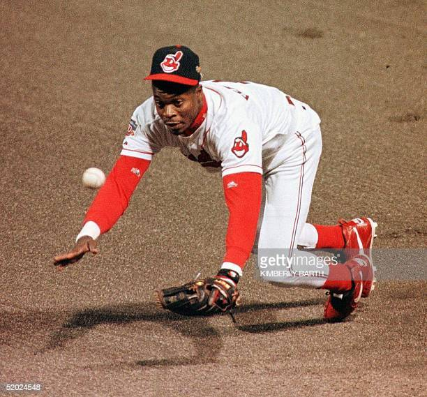 Second baseman Tony Fernandez of the Cleveland Indians makes a diving stop of a ball hit by catcher Charles Johnson of the Florida Marlins 21 October...