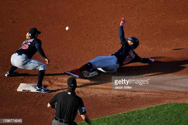 Second baseman Tyler Freeman tags out Francisco Lindor of the Cleveland Indians during the second inning of an intrasquad game at Progressive Field...