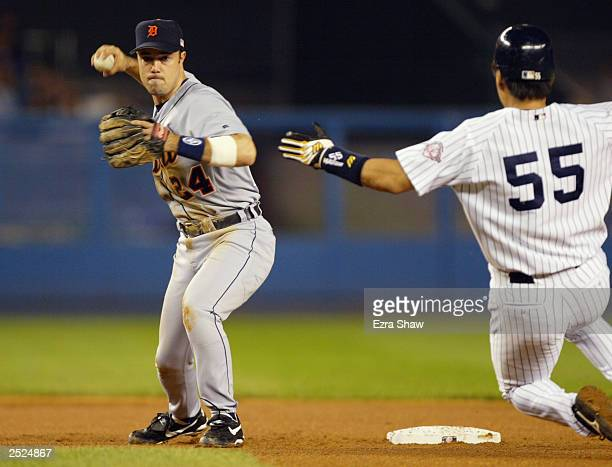 Second baseman Warren Morris of the Detroit Tigers forces out right fielder Hideki Matsui of the New York Yankees during the game at Yankee Stadium...