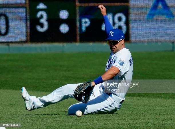 Second baseman Whit Merrifield of the Kansas City Royals fields a ball off the bat of David Dahl of the Texas Rangers that was scored an infield...