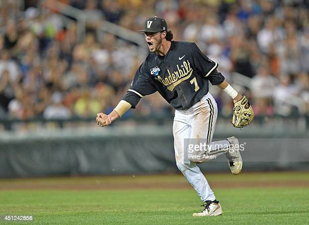 Second basemen Dansby Swanson of the Vanderbilt Commodores celebrates after recording the final out of the eighth inning against the Virginia...