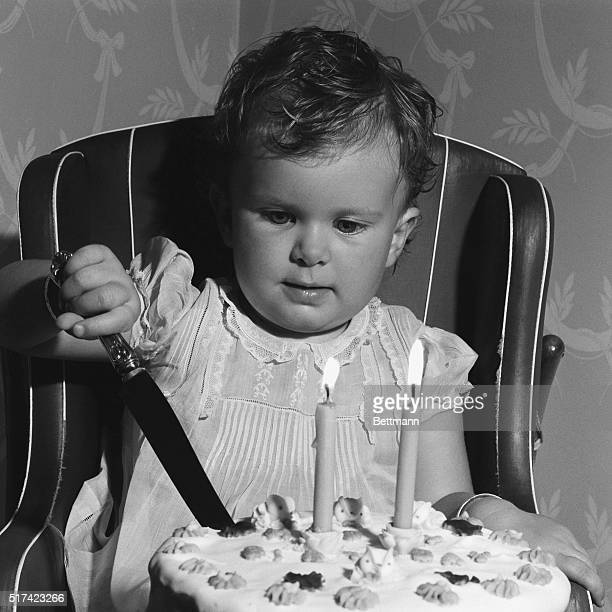 Second birthday Photo shows a baby cutting the birthday cake Undated
