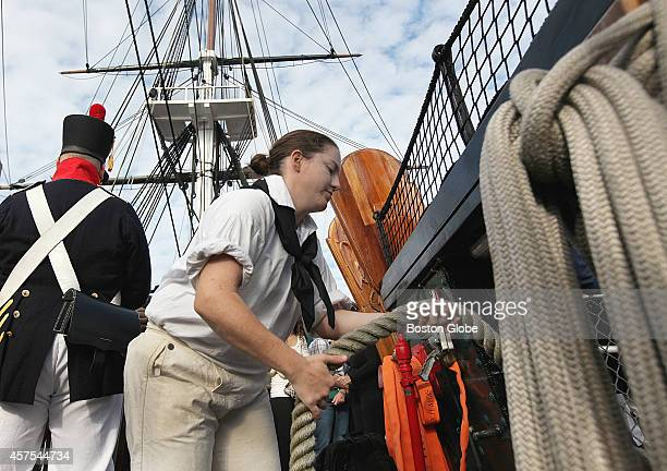 Second class petty officer Melissa Moore fed lines aboard the USS Constitution as it prepared to leave the dock for Castle Island in South Boston...