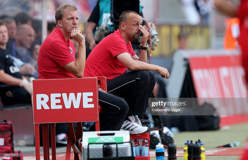 Second coach Andre Trulsen and Head coach Holger Stanislawski of Cologne looks on during Pre-Season Friendly game between FC Cologne and FC Arsenal at Rhein Energie Stadium on August 12, 2012 in Cologne, Germany.