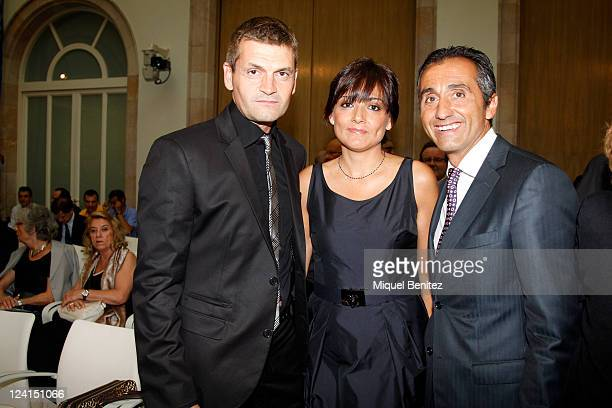 Second Coach of Barcelona's FC Tito Vilanova his wife Montse Enchaure and PR FC Barcelona Manuel Estiarte attend the gold medal ceremony honouring...