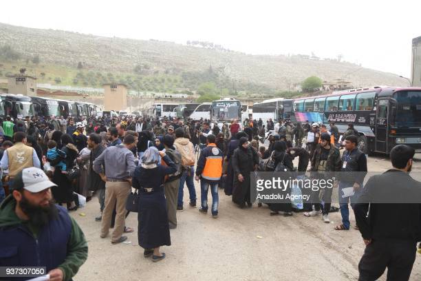 A second convoy of vehicles are seen as they carry civilians and opposition fighters from the Damascus suburb of Eastern Ghouta arrived in Hama...