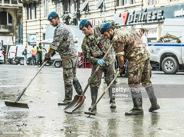 Second day of cleaning and repairing for Army and young voluntary now called 'Angeli del Fango' after flood waters swept through the city of Genoa...